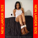 Black girl bound in boots & mini-skirt